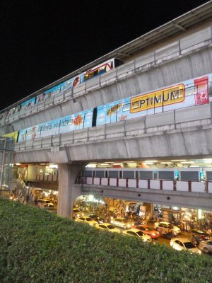 Skytrains on multiple levels above the street outside the Siam Paragon