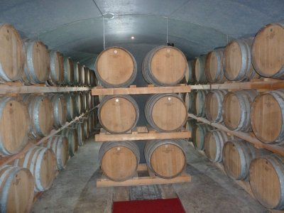 Wine aging in oak barrels in the cellars of the Leeuwin Estate