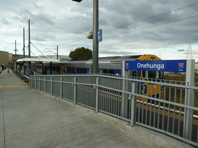 Auckland suburban train about to leave Onehunga Railway Station for the Britomart