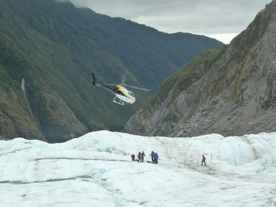 A helicopter taking off from the glacier returning hikers back to the village