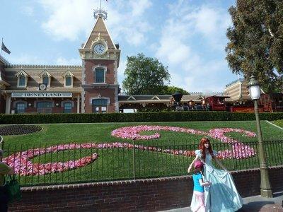 Disney Princess posing in front of the Main Street USA Railway Station in Disneyland
