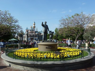 Walt Disney and Mickey Mouse's Statue in the plaza in front of Sleeping Beauty's Castle