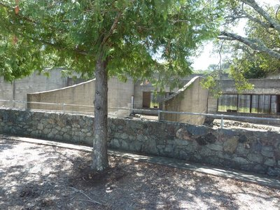 Fenced enclosures once used to cage animals for the private zoo