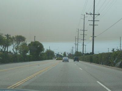 Brush fire smoke begins to darken the skyline