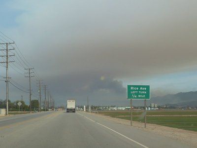 Brush fire smoke billowing in the distance