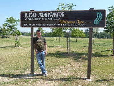 Me by the entrance to the Leo Magnus Cricket Complex in Los Angeles