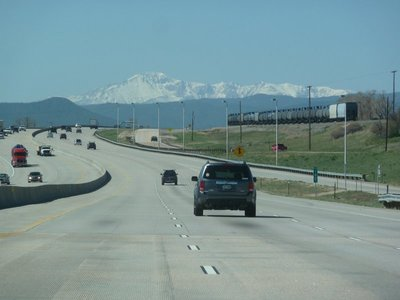 Freeway and railway both heading south towards Colorado Springs and Pikes Peak