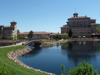 The bridge across the lake back to the main building at the Broadmoor Hotel