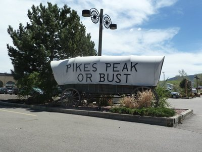 'Pikes Peak or Bust' covered wagon outside the Ghost Town Museum in Colorado Springs