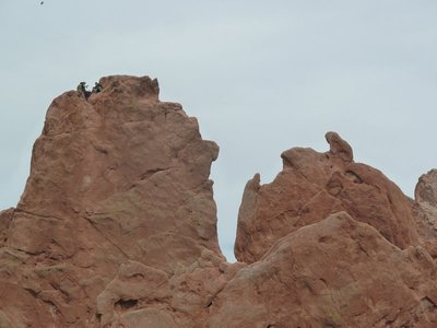 Close up of the climbers on top of the 'Cathedral Spires' Rock Formation