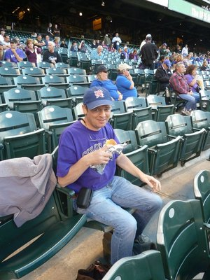Me enjoying a 'Rockie Dog' while watching the baseball