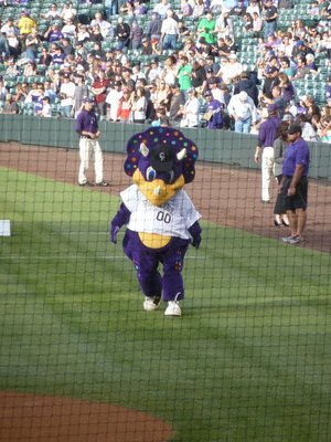 'Dinger' - the Colorado Rockies Mascot - up to no good again outside the away team's dugout