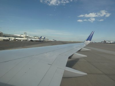 Our plane backing away from the terminal at Denver Airport