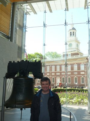 Me stood by the Liberty Bell with Independence Hall through the window behind me