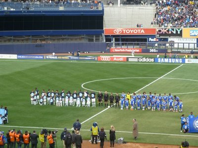 The two teams line-up before the start of the match