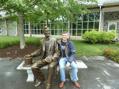 Me sat beside a life size statue of Abraham Lincoln outside the Visitor's Center