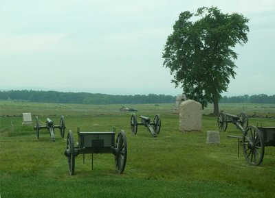Canon at the Angle, target of Pickett's Charge which was launched from the Virginia Monument which can be seen on the left hand side of the tree line in the distance