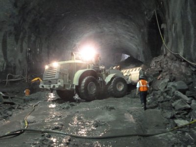 Another excavator removing rubble from the new subway tunnel