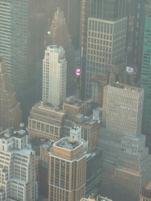 Close up from the 102nd floor of Times Square tucked away amongst its surrounding tall buildings