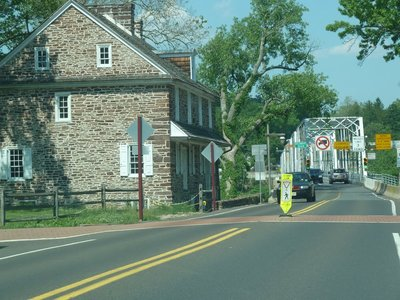Looking back at McConkey's Ferry Inn and the truss bridge on the Pennsylvania side of the Delaware River at Washington Crossing