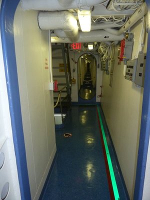 A corridor of bulkhead doors below deck aboard the USS New Jersey