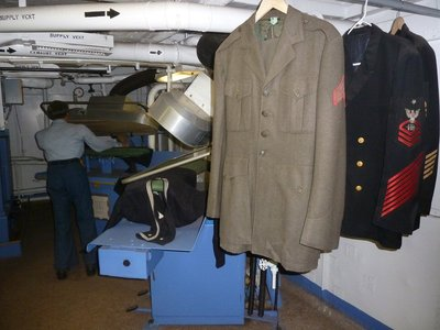 Smartly pressed uniforms at the Dry Cleaners aboard the USS New Jersey