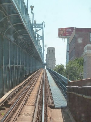 The subway comes out into daylight and climbs onto the Ben Franklin Bridge to cross the Delaware River