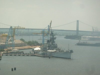 The USS New Jersey Battleship from a subway train crossing the Ben Franklin Bridge