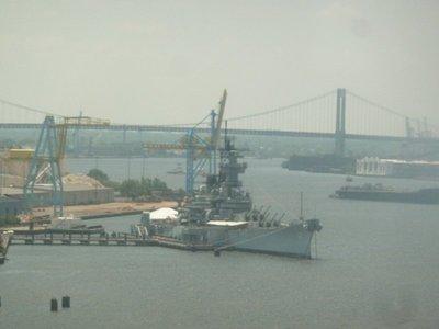 The USS New Jersey Battleship from a subway train crossing the Ben Franklin Bridge