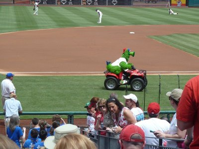 Phillie Phanatic, the club mascot, racing around the field while the players warm up