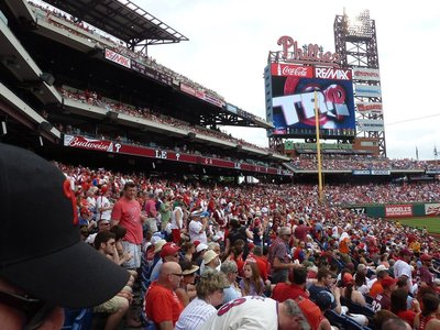 The sea of red shirted Phillies fans celebrate a 'triple' (batter reaching 3rd base)