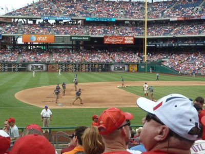 Raking the infield after the 6th innings
