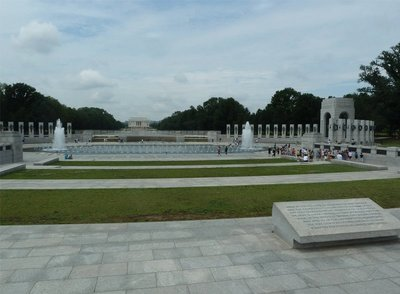 The National World War II Memorial with the Lincoln Memorial behind it at the other end of the Reflecting Pool