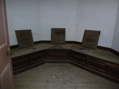 Inside the 'necessary' there were 3 seats - going to the toilet could be a communal activity