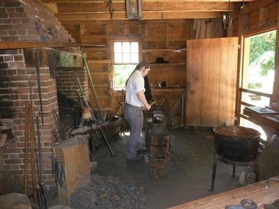 Making nails inside the Blacksmith's Shop