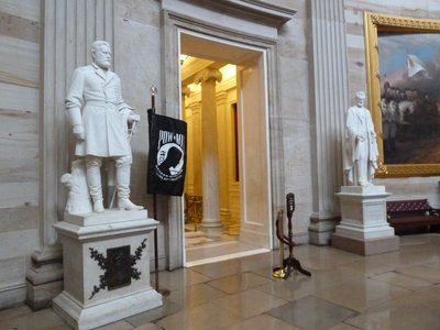 Statues of Presidents Grant and Lincoln beside the POW/MIA Flag in the Rotunda