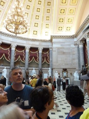 Our guide (you can just about make her out in her red uniform) demonstrates the whisper point from across National Statuary Hall