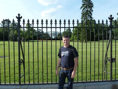 Me by the railings of the South Lawn in front of the White House