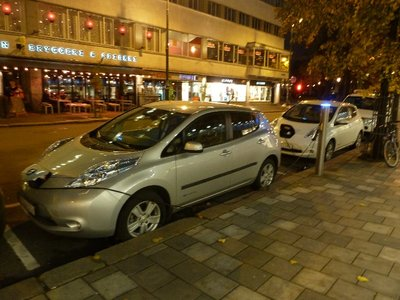 Electric cars plugged into a public recharging point in Central Oslo