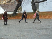 Locals practising their sword fighting skills on the parade ground of Bergen Castle