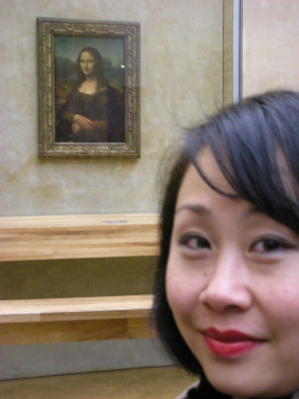 I got to see the Mona Lisa that the Louvre in Paris