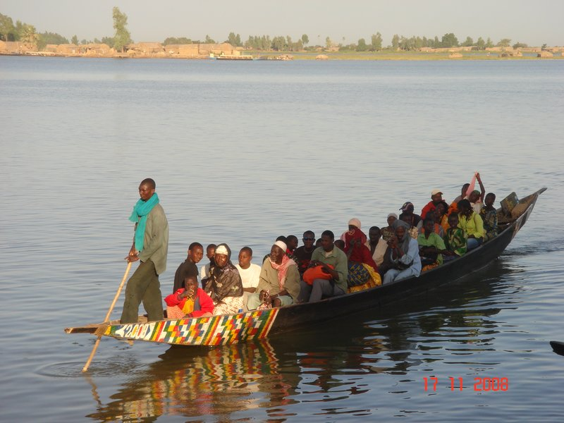 Boat carrying passengers in Niger River at Mopti