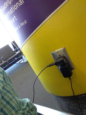 When stranded in the terminal, he who controls the power outlets rules the world.