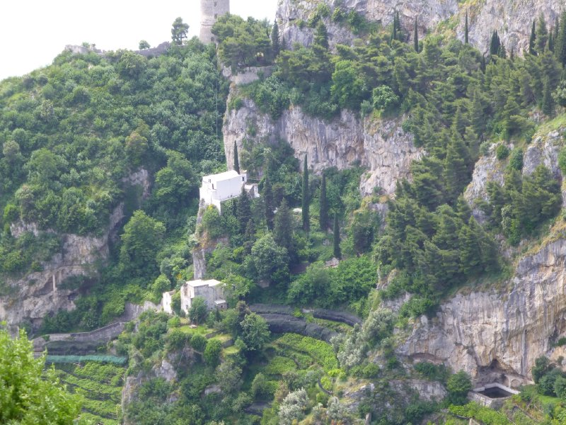 Houses on the cliff below the tower