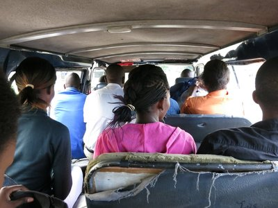 At the back of a minibus
