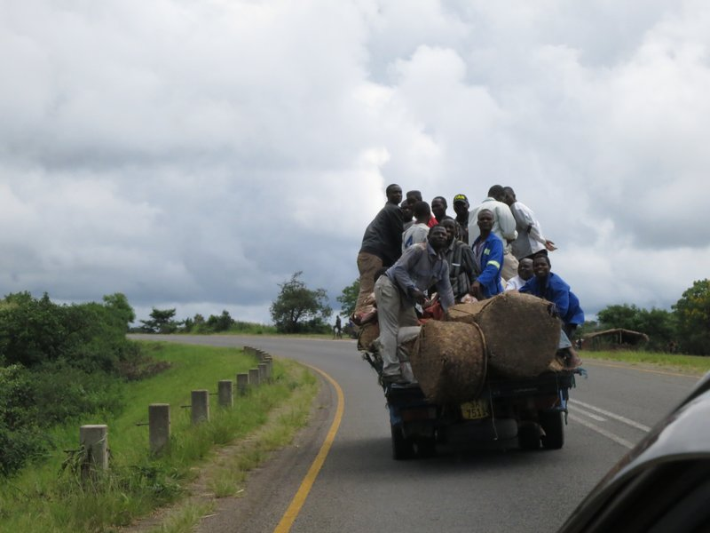 Flat bed truck with people