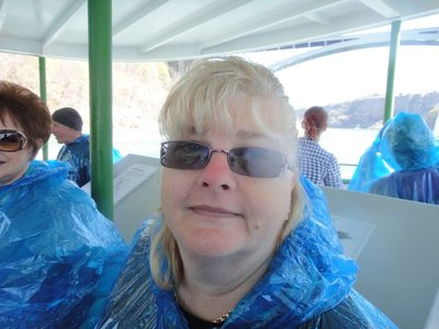 Colleen in her raincoat on Maid of the Mist