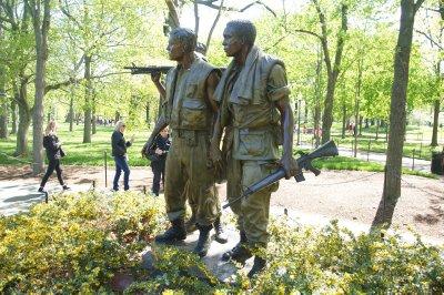 National Vietnam War Memorial - statues near the Memorial Wall
