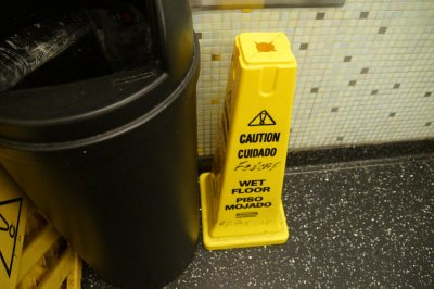 Sign in Mens Toilet - so it is not water on the floor!