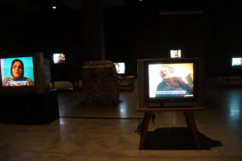 MONA - Kuba - a large room with many tv's  running short films (no two TVs or chairs the same)